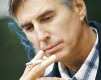 Why do heart attack patients fail to fill prescriptions for medications to help them quit smoking?